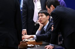 In this handout photo provided by Google DeepMind on Tuesday, Lee Se-Dol (seated), one of the greatest modern players of the ancient board game Go, reviews the game after the fifth and final game of the Google DeepMind Challenge Match against Google-developed supercomputer AlphaGo at a hotel in Seoul, South Korea.