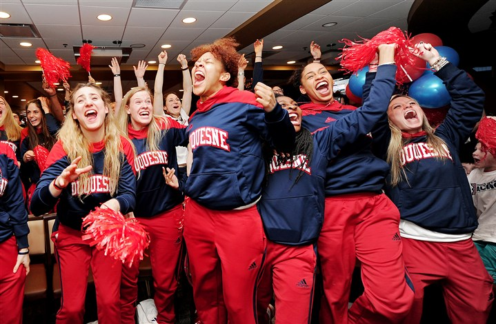 20160314mfdukessports01 Members of the Duquesne women's basketball team celebrate as their name is announced among the field for the NCAA tournament Monday at a watch party at the Rivertown Hall of Fame Club at PNC Park.