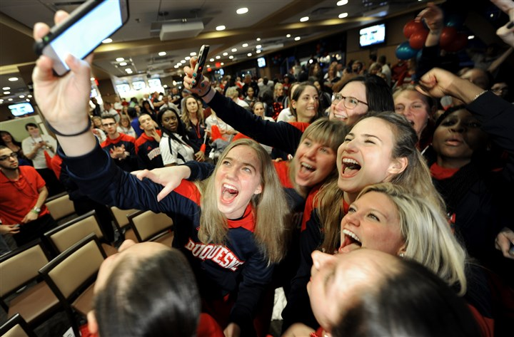 20160314mfdukessports02-1 Members of the Duquesne women's basketball team celebrate after their name was announced among the field for the NCAA tournament Monday at a watch party at the Rivertown Hall of Fame Club at PNC Park.
