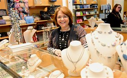Lisa Slesinger, co-owner of the Larrimor's clothing store on Fifth Avenue, Downtown, is mounting a campaign to lure beauty retailers to the business center of the city.