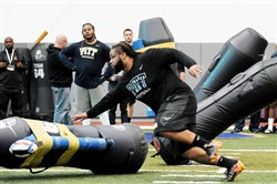 Khayhin Mosley-Smith, a Woodland Hills High School graduate, runs in a drill during Pitt's Pro Day March 16 at the UPMC Sports Performance Complex in the South Side.