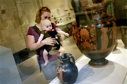 Christine Nughfer of Toledo holds her son, Max, 7 months, during a free Baby Art Tour in 2013 at the Toledo Museum of Art. The event aims to teach parents how to facilitate early visual literacy skills for their children.
