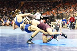 Virginia Tech's Solomon Chishko, a Canon-McMillan graduate, takes down Chattanooga's Mike Pongracz at the NCAA wrestling championships Thursday at Madison Square Garden.