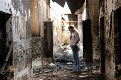 An employee of Doctors Without Borders walks inside the charred remains of the organization's hospital in Oct. 2015 after it was hit by a U.S. airstrike in Kunduz, Afghanistan.