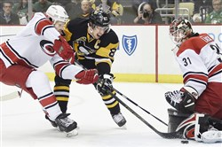 Sidney Crosby scores past Hurricanes goalie Eddie Lack in the first period Thursday at Consol Energy Center.