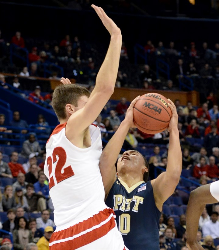 Wisconsin's Ethan Happ and Pitt's James Robinson Pitt's James Robinson looks for room against Wisconsin's Ethan Happ in the first half Friday of the first round of the NCAA tournament in St. Louis.
