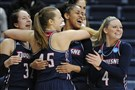 From left, Duquesne's April Robinson, Emilie Gronas, Deva'Nyar Workman, and Chassidy Omogrosso celebrate in the final seconds of their game against Seton Hall in the NCAA Tournament, Saturday, in Storrs, Conn. Duquesne won 97-76.