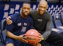 Duquesne guard Derrick Colter, left, and assistant coach John Rhodes have formed a strong bond as fellow cancer survivors.