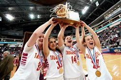 From left, North Catholic players Sam Breen, Elyssa Paras, Abby Goetz and Lillia Smyers celebrate after defeating Lourdes Regional 56-33 in the PIAA Class A championship game at Giant Center in Hershey.