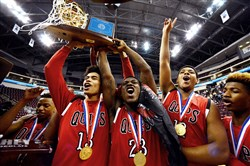 Aliquippa players celebrate after defeating Mastery Charter North 68-49 in the PIAA Class AA championship game at Giant Center in Hershey, Pa., on Saturday.