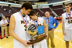 Mars John Castello, left, and Christian Schmitt comfort each other after losing to Neumann-Goretti, 99-66, in the PIAA Boy's AAA Championship game Friday at the Giant Center in Hershey.