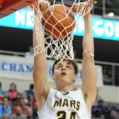 Mars' Robby Carmody dunks against Neumann-Goretti in the PIAA Class AAA boys championship game at Giant Center in Hershey, Pa.