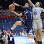 Duquesne's Deva'Nyar Workman drives to the basket as Seton Hall's Jordan Mosley, right, defends Saturday in Storrs, Conn.
