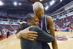 Pittsburgh Public Schools superintendent Linda Lane comforts Allderdice Jordan Rawls after the team lost to Roman Catholic 73-62 in the PIAA Boy's AAAA Championship game at Giant Center in Hershey on Saturday, March 19.