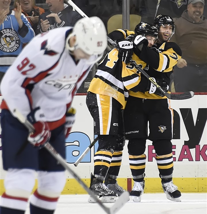 20160320pdPenguinsSports04 Matt Cullen hugs Tom Kuhnhackl after scoring against the Washington Capitals in the second period Sunday at Consol Energy Center.