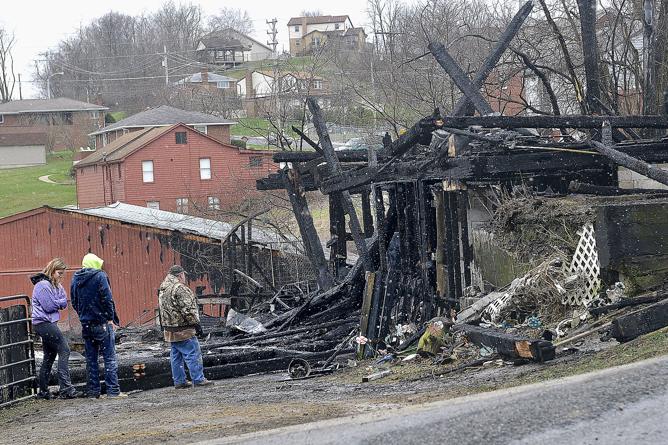 20160320lrhorsebarnfire05-3 Firefighters probe the ashes from a fire at Quest Stables at the intersection of Wallace and Ridge Road in South Park Township, in March 2016. Seven horses, two goats, a pig and an undetermined number of ducks and chickens perished in the barn fire.
