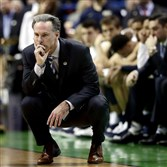 Pitt coach Jamie Dixon watches the final moments of last season's NCAA tournament game against Wisconsin. It would end up being Dixon's last game as Pitt head coach.