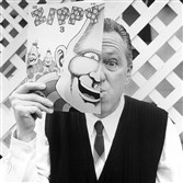 Bill Griffith, creator of Zippy the Pinhead, with his creation in a portrait.