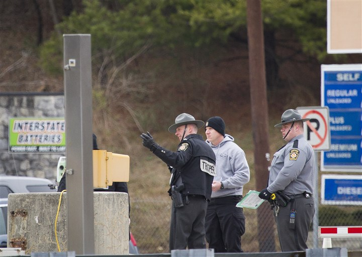 Turnpike Shooting-7 Police investigate the scene of Sunday's fatal shooting and attempted armed robbery at the Pennsylvania Turnpike's Fort Littleton interchange.