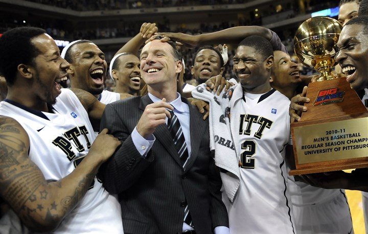 WEB_Big East regular season champions 2011 (Copy) Jamie Dixon is congratulated by his players after Pitt defeated Villanova and clinched the regular-season Big East championship in 2011.
