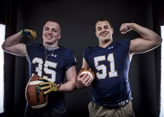 Central Catholic players David Adams, left, and teammate Kurt Hinish model Notre Dame jerseys.