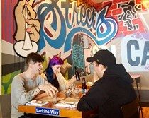 Patrons enjoy lunch Tuesday at the newly opened Streets on Carson, on the South Side.