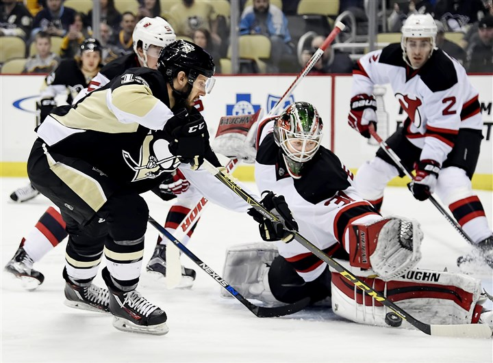 20160324pdPenguinsSports01 Penguins centerman Nick Bonino is stopped by Devils goalie Scott Wedgewood in the first period Thursday at Consol Energy Center.