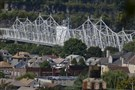 The Ambridge community sits in the foreground of the Ambridge-Aliquippa Bridge.