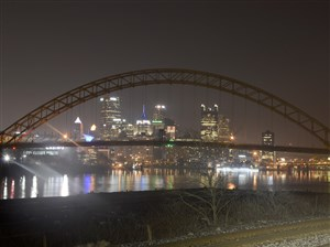 The West End Bridge frames the Pittsburgh skyline as it spans over the Ohio River.