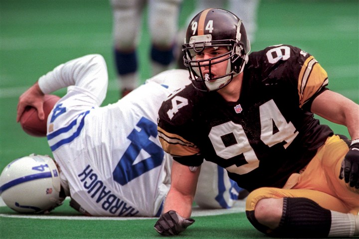Chad Brown Harbuagh Steelers linebacker Chad Brown rolls away from Colts QB Jim Harbaugh after one of Brown's three sacks Dec. 29, 1996, at Three Rivers Stadium.