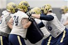Offensive lineman Alex Bookser, right, works against Alex Paulina during Pitt's Monday practice on the South Side.