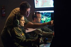 "From left,  actress Phoebe Fox, director Gavin Hood and actor Aaron Paul on the set of ""Eye in the Sky."""