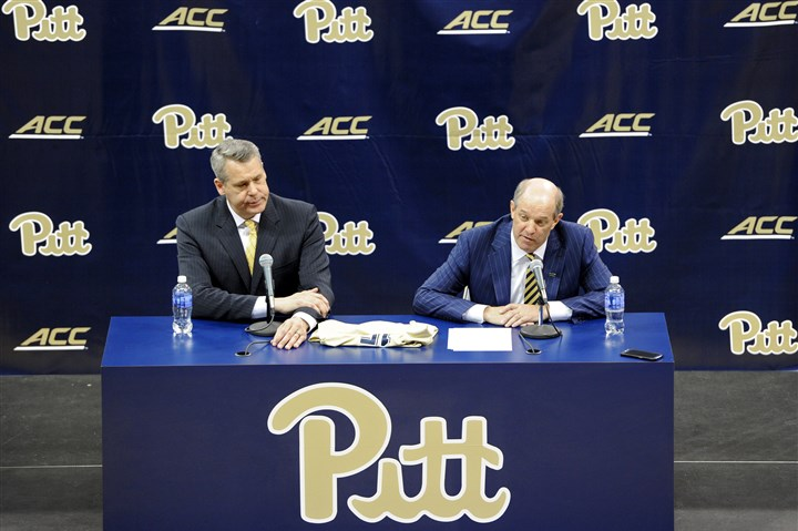 20160328mfpittsports06-1 New Pitt head men's basketball coach Kevin Stallings talks to the media next to athletic director Scott Barnes, left, Monday at a press conference at Petersen Events Center.
