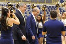 Pitt athletic director Scott Barnes, second from left, and men's basketball coach Kevin Stallings, third from left, enter for Stallings' introductory press conference March 28 at the Petersen Events Center.
