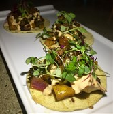 The veggie tacos -- grilled pineapple, onion, shishito peppers, falafel crouton, micro greens and a harissa aioli -- at Hidden Harbor in Squirrel Hill.