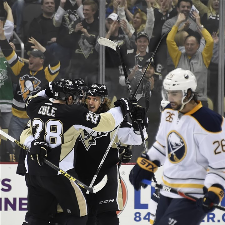 20160329pdPenguinsSports03 Penguins (28) Ian Cole and (far right) Carl Hagelin celebrate fourth goal of the second period by Nick Bonino (middle) against the Sabres at the Consol Energy Center Tuesday night.