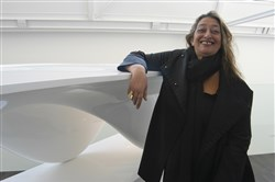 "Zaha Hadid with the ""Aqua"" table she designed in 2005."