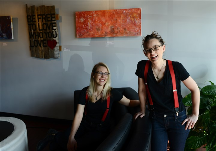 "20160401rldMixtape02-1 Mixtape co-owners Elaina Holko, left, and Katie Molchan at their cafe, event space and ""music gallery"" in Garfield. Mixtape is the first business to receive a ""Worker-Approved Business"" designation by Pittsburgh United and city Councilwoman Deb Gross."