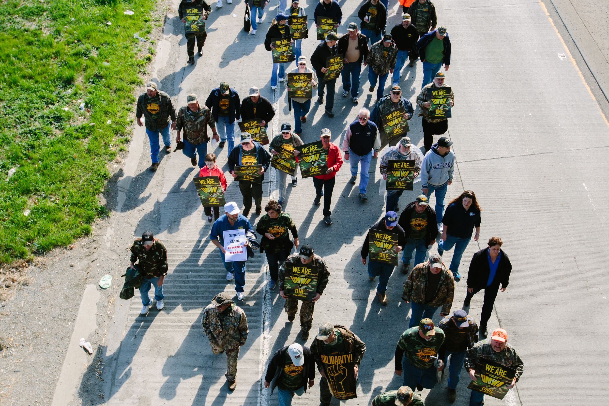 20160401arUMWA-March05-2 Thousands of mine workers and supporters march down E Roy Furman highway in Waynesburg for a rally by the United Mine Workers of America on April 1.