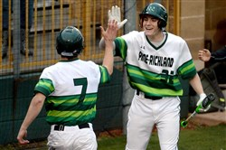 Pine-Richland's Chris Grguras is congratulated by Josh Johnson after scoring against Latrobe in a non-section game April 1 at Kelly Automotive Park in Butler. The Rams won, 7-4.