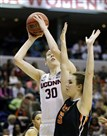 Connecticut's Breanna Stewart shoots against Oregon State's Samantha Siegner in the first half of an NCAA tournament national semifinal game Sunday in Indianapolis.