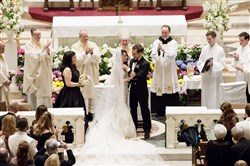 Alexandra Good and Lt. Brian Linville turn to face friends and family gathered for their wedding at St. Paul Cathedral in Oakland.