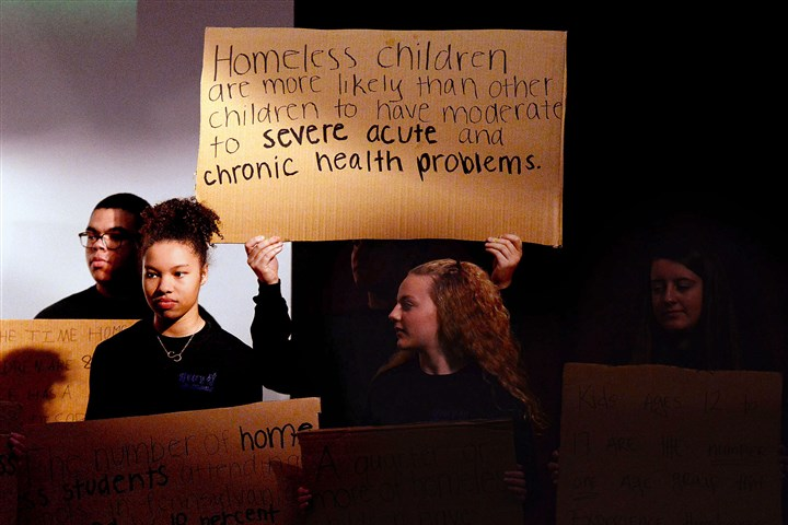 20160403MWHhomelessLocal01-15 High school students hold signs listing statistics about homeless children Sunday as part of the second annual Hope Through Creativity event at the East Liberty Presbyterian Church.