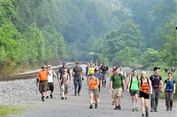 People walk along train tracks in the Rachel Carson Trail Challenge, a 34-mile endurance hike from Harrison Hills Park to North Park. There's also an 18-mile Homestead Challenge and an 8-mile Friends & Family Challenge.