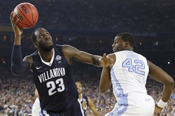 This year's national title game between Daniel Ochefu, left, and Villanova and Joel James, right, and North Carolina aired on cable and drew a record-low rating.