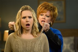 "Kristen Bell gets some fashion advice from Melissa McCarthy in ""The Boss."""
