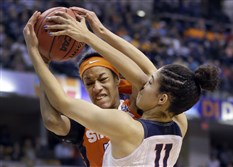 Syracuse's Briana Day, left, and Connecticut's Kia Nurse battle for a rebound in the second half of the NCAA Women's championmship Tuesday night in Indianapolis.