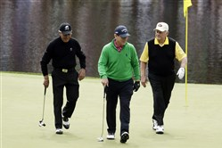 From left, Gary Player, Tom Watson and Jack Nicklaus walk off the eighth hole during the par three competition at the Masters golf tournament Wednesday in Augusta, Ga.