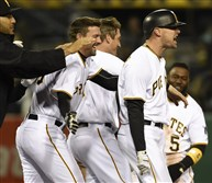 Pittsburgh Pirates Jordy Mercer with game winner against the Cardinals is mobbed by teammates at PNC Park.