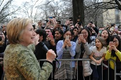 Democratic presidential candidate Hillary Clinton greets people who were waiting outside in the overflow area outside Skibo Gymnasium at Carnegie Mellon University during her visit on April 6.